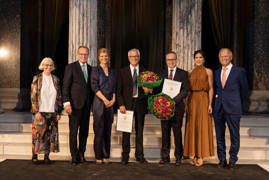 Photo from The Carlsberg Foundation's Research Awards 2019. From left acting Secretary General of the Royal Academy Marita Akhøj Nielsen, Chairman of the Board of the Carlsberg Foundation Flemming Besenbacher, Minister of Education and Research Ane Halsbo-Jørgensen, recipient Thomas Kiørbo, recipient Mikael Rask Madsen, HRH Crown Princess Mary and President of the Royal Academy Mogens Høgh Jensen