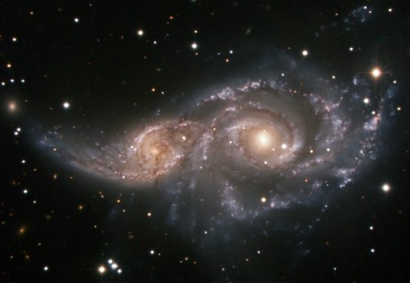 The image shows two galaxies that both look like the Milky Way but that are located in the stellar constellation Big Dog. In billions of years, the two will fuse into one big galaxy. Equally so, this might have been what it looked like when the Milky Way and Gaia-Enceladus collided approximately 11 billion years ago.
