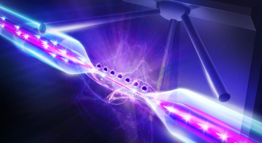 The image shows light particles during the meeting with atoms while they pass through a glass fiber.
