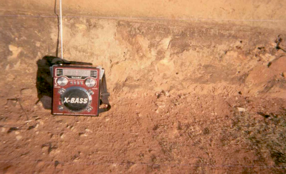 The winning photo shows a radio on the ground in front of a building in Zimbabwe.